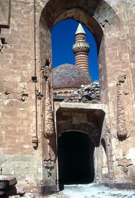 Minaret & cupola seen through arch, Ishak Pasa's Palace.