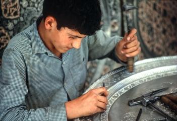 A metal worker in Meidan-I-Shah, Isfahan.